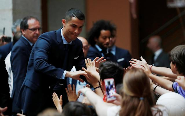 Soccer Football - Real Madrid celebrate winning the Champions League Final - Madrid, Spain - May 27, 2018 Real Madrid's Cristiano Ronaldo celebrates with fans REUTERS/Javier Barbancho