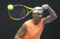 Spain's Rafael Nadal hits a forehand during practice session ahead of the Australian Open in Melbourne, Australia, Sunday, Feb. 7, 2021.(AP Photo/Hamish Blair)