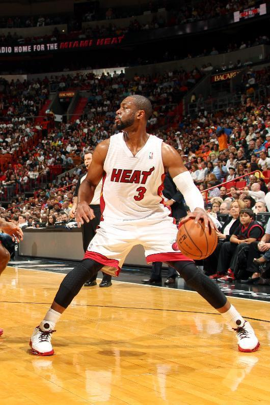 MIAMI, FL - April 16: Dwyane Wade #3 of the Miami Heat handles the ball against the Philadelphia 76ers at the American Airlines Arena in Miami, Florida on April 16, 2014. (Photo by Issac Baldizon/NBAE via Getty Images)