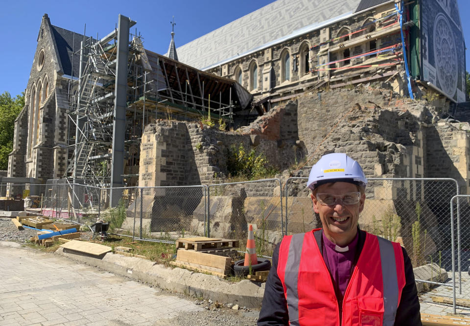 Peter Carrell, the Anglican bishop of Christchurch, stands outside the 2011 earthquake damaged Christ Church Cathedral in central Christchurch, New Zealand on Feb 11, 2021. The Christ Church Cathedral was arguably New Zealand's most iconic building before much of it crumbled during an earthquake 10 years ago. The years of debate that followed over whether the ruins should be rebuilt or demolished came to symbolize the paralysis that has sometimes afflicted the broader rebuild of Christchurch. But as the city on Monday, Feb. 22, 2021 marks one decade since the quake struck, killing 185 people and upending countless more lives, there are finally signs of progress on the cathedral. It's being rebuilt to look much like the original that was finished in 1904, only with modern-day improvements to make it warmer and safer. (AP Photo/Nick Perry)