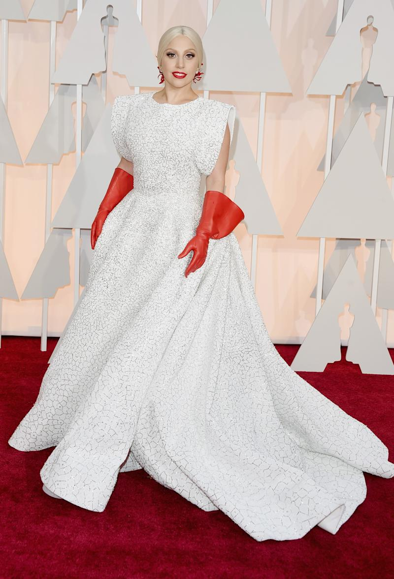 Wearing a custom, glittering Azzedine Alaia gown to the 87th Annual Academy Awards.