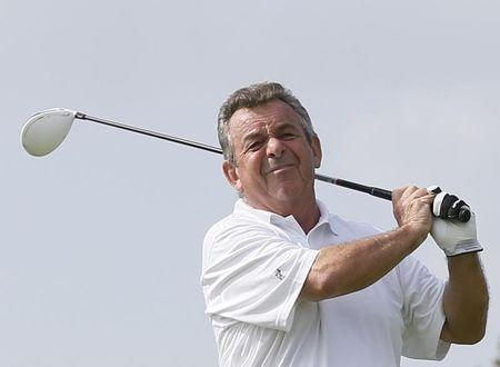Tony Jacklin of England tees off on the first hole during the first round of the Mission Hills World Celebrity Pro-Am golf tournament in Haikou
