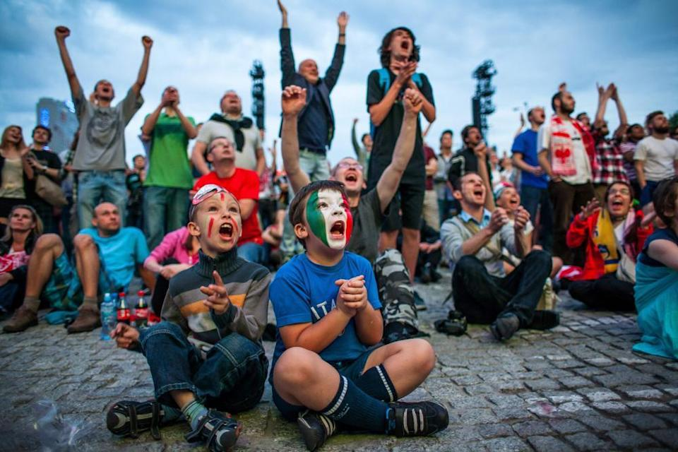 Italy fans cheer in the Warsaw fanzone during their semi-final against Germany at Euro 2012.