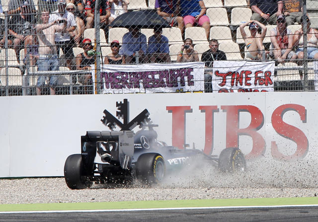 Mercedes driver Lewis Hamilton of Britain crashes during the qualifying of the German Formula One Grand Prix in Hockenheim, Germany, Saturday, July 19, 2014. The German Grand Prix will be held on Sunday.(AP Photo/Michael Probst)