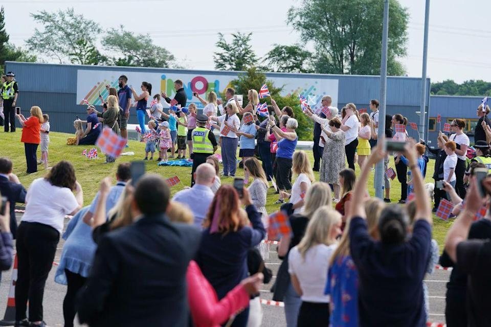 <p>Crowds gather to greet Queen Elizabeth II and Prince William as they arrive at AG Barr's factory in Cumbernauld, Scotland.</p>