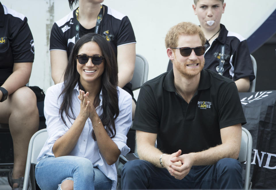 Prince Harry and Meghan Markle sat together in public for the very first time [Photo: Getty]