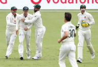 Australia's Steve Smith, second left, is congratulated by teammates after taking a catch to dismiss India's Shubman Gill during play on day two of the fourth cricket test between India and Australia at the Gabba, Brisbane, Australia, Saturday, Jan. 16, 2021. (AP Photo/Tertius Pickard)
