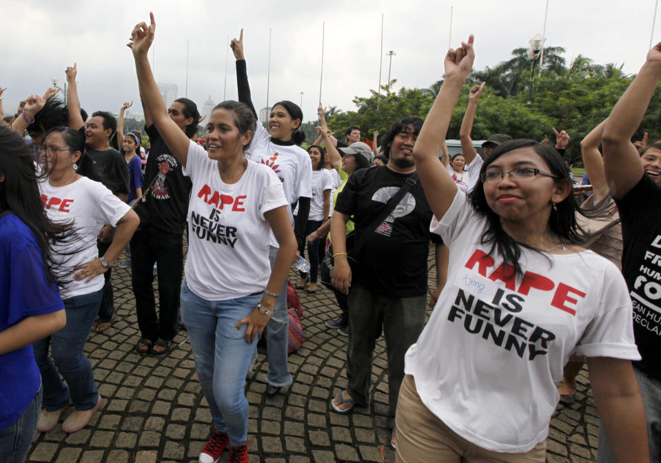 """In this Thursday, Feb. 14, 2013 photo, Indonesian women take part in the """"One Billion Rising"""" campaign that calls to an end to violence against women, in Jakarta, Indonesia. Women in this social media-obsessed country have been rallying, online and on the streets, against sexist comments and attacks on women. The response is seen as a small step for women's rights in Indonesia, where the government is secular and most people practice a moderate form of Islam. (AP Photo/Dita Alangkara)"""