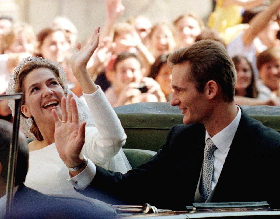 Spanish Infanta Cristina and her husband Inaki Urdangarin wave to cheering crowd from an open car after their wedding at Barcelona's cathedral on October 4. Princess Cristina married Olympic handball star Urdangarin inside a majestic Gothic cathedral filled with royalty from around the world.