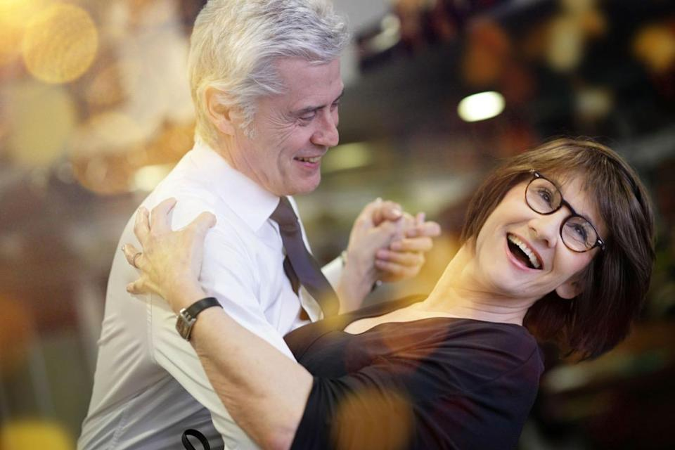 elderly couple dancing together at the dance hall