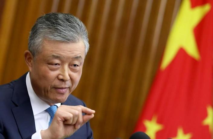 Chinese Ambassador to Britain Liu Xiaoming gestures during a news conference in London
