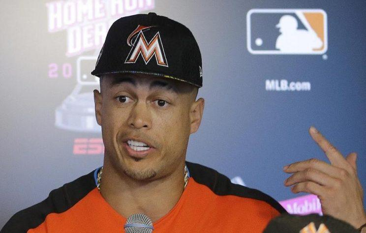Giancarlo Stanton is quickly losing his patience with the Marlins. (AP)