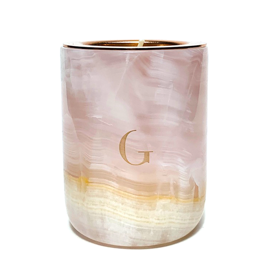 "<p><strong>Gilded Body</strong></p><p><strong>$68.00</strong></p><p><a href=""https://gildedbody.com/collections/the-marble-candle/products/pink-onyx-marble-candle"" rel=""nofollow noopener"" target=""_blank"" data-ylk=""slk:SHOP IT"" class=""link rapid-noclick-resp"">SHOP IT</a></p><p>Find a prettier candle for your coffee table than Gilded Body's pink onyx marble candle, which includes a 40-hour burn time. I'll wait!</p>"