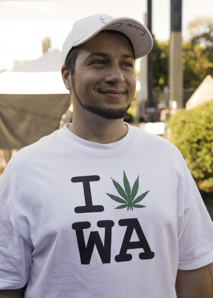 An attendee, who wished to remain anonymous, wears a pro-marijuana shirt at the High Times U.S. Cannabis Cup in Seattle, Washington September 8, 2013. Washington state was one of the first states to legalize marijuana for recreational use after approving separate ballot initiatives last year, even as the drug remains illegal under federal law. The Cup features exhibitions as well as a marijuana growing competition. REUTERS/Jason Redmond (UNITED STATES - Tags: DRUGS SOCIETY)