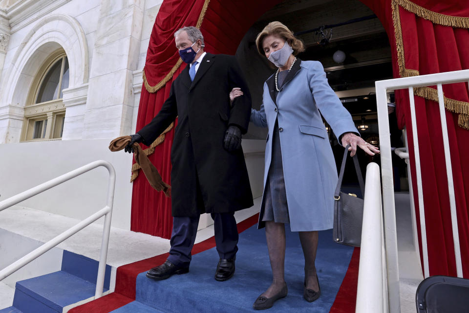 Former U.S President George W. Bush and his wife Laura Bush arrive to attend the 59th Presidential Inauguration at the U.S. Capitol in Washington, Wednesday, Jan. 20, 2021. Joe Biden was sworn in as the 46th president of the U.S. and Kamala Harris became the first woman vice president. (Jonathan Ernst/Pool Photo via AP)