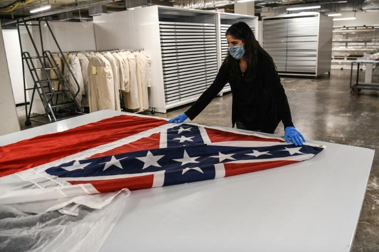 The old Mississippi state flag with its Confederate emblem has been consigned to museums as voters pick a new one