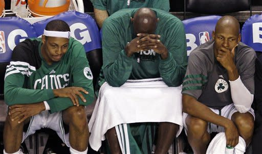From left, Boston Celtics' Paul Pierce, Kevin Garnett and Ray Allen sit on the bench late in the fourth quarter while trailing the Miami Heat in Game 6 of the NBA basketball Eastern Conference finals, Thursday, June 7, 2012, in Boston. Miami won 98-79. (AP Photo/Charles Krupa)
