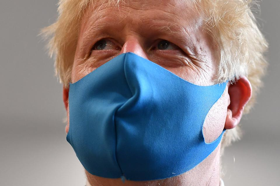 LONDON, UNITED KINGDOM - JULY 13: Britain's Prime Minister Boris Johnson, wearing a face mask or covering due to the COVID-19 pandemic, visits the headquarters of the London Ambulance Service NHS Trust  on July 13, 2020 in London, England.  (Photo by Ben Stansall-WPA Pool/Getty Images)
