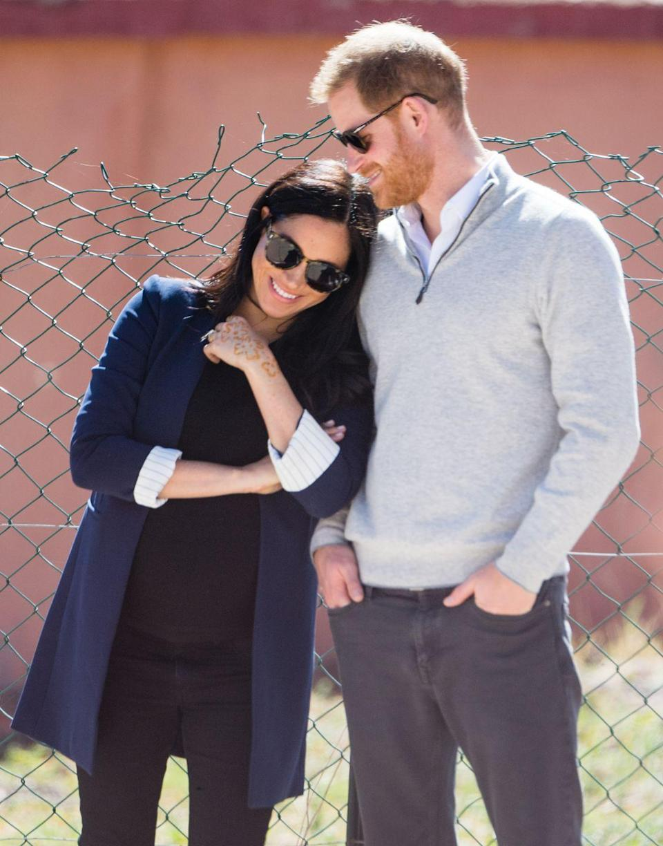 <p>Here, Prince Harry and Meghan share a moment together while on the royal tour of Morocco. The visit was her final international tour before welcoming her first child.</p>