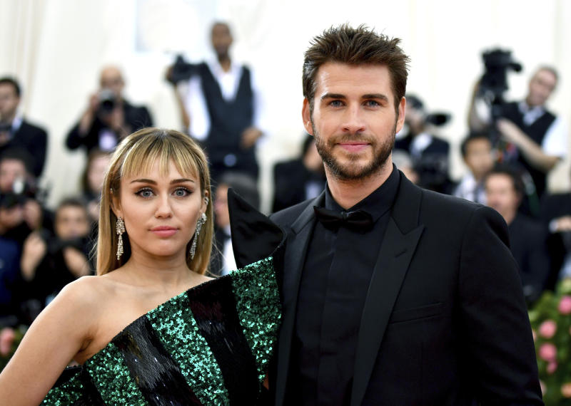 """FILE - In this May 6, 2019 file photo, Miley Cyrus, left, and Liam Hemsworth attend The Metropolitan Museum of Art's Costume Institute benefit gala celebrating the opening of the """"Camp: Notes on Fashion"""" exhibition in New York. Cyrus and Hemsworth have separated after less than a year of marriage. A representative for the singer said Saturday, Aug. 10 the pair decided a break was best while they focus on """"themselves and careers."""" Cyrus and Hemsworth, who starred in """"The Hunger Games"""" films, have been an on-and-off again couple for more than a decade. They married in December 2018. (Photo by Charles Sykes/Invision/AP, File)"""