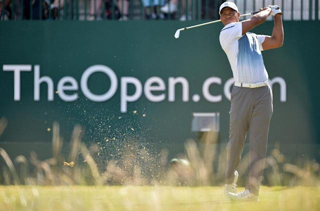 Tiger Woods tees off on the opening day of the British Open Golf Championship in Hoylake, north-west England on July 17, 2014 (AFP Photo/Paul Ellis)
