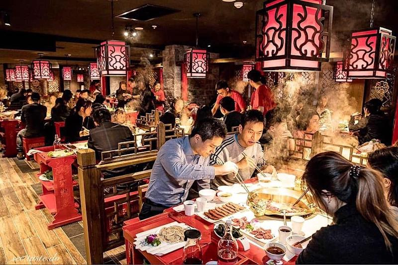 Many patrons are eating inside the Da Long Yi restaurant in Sydney's Chinatown.