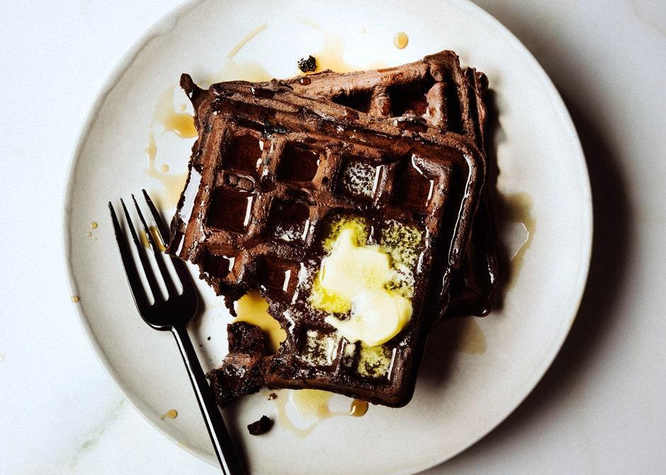 """Buttermilk brings slight tang and moisture to the batter, while olive oil offers fruity richness. <a href=""""https://www.bonappetit.com/recipe/dark-chocolate-waffles?mbid=synd_yahoo_rss"""" rel=""""nofollow noopener"""" target=""""_blank"""" data-ylk=""""slk:See recipe."""" class=""""link rapid-noclick-resp"""">See recipe.</a>"""