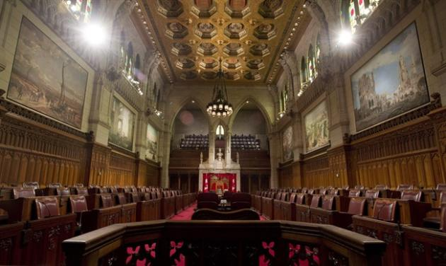 The federal government should outlaw membership in a terrorist group, bar radicals from Canada and look at forbidding the glorification of extremists to protect the Canadian way of life, says a Senate committee. The Senate chamber sits empty on September 12, 2014 in Ottawa. THE CANADIAN PRESS/Adrian Wyld