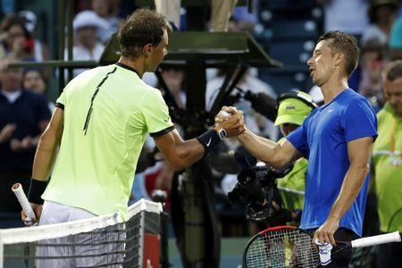 Mar 26, 2017; Miami, FL, USA; Rafael Nadal of Spain (L) shakes hands with Philip Kohlschreiber of Germany (R) after their match on day six of the 2017 Miami Open at Crandon Park Tennis Center. Nadal won 0-6, 6-2, 6-3. Mandatory Credit: Geoff Burke-USA TODAY Sports