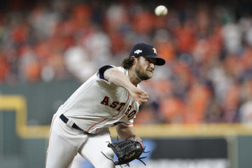 Houston Astros starting pitcher Gerrit Cole throws to a Tampa Bay Rays batter during the first inning of Game 5 of a baseball American League Division Series in Houston, Thursday, Oct. 10, 2019. (AP Photo/Michael Wyke)