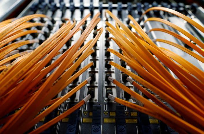 FILE PHOTO: Optical fibre cables are seen in a telephone exchange in Rome