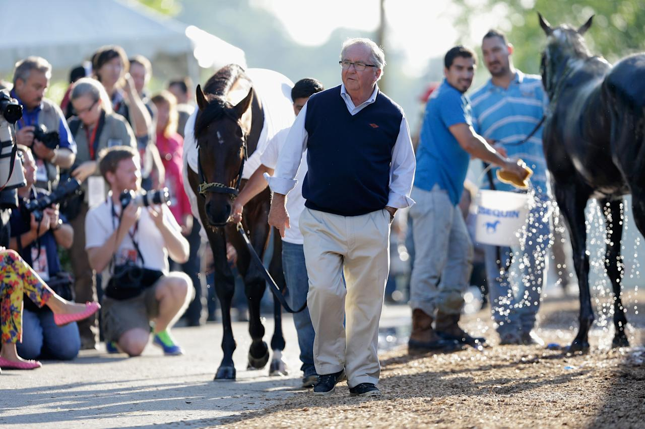 BALTIMORE, MD - MAY 17: Trainer Shug McGaughey  walks in front of Kentucky Derb winner and Preakness entrant Orb after the horse got a bath following a workout in preparation for the 138th Preakness Stakes at Pimlico Race Course on May 17, 2013 in Baltimore, Maryland.  (Photo by Rob Carr/Getty Images)
