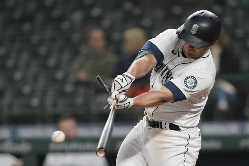 Seattle Mariners' Kyle Seager breaks his bat as he singles against the San Francisco Giants during the fifth inning of a baseball game Saturday, April 3, 2021, in Seattle. (AP Photo/Ted S. Warren)