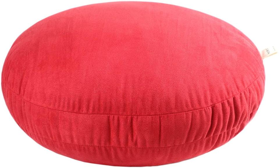 """<strong><h2>Hodeco Round Throw Pillow</h2></strong>""""I'll be honest, I'm not a <a href=""""https://www.refinery29.com/en-us/2019/12/8868058/mindfulness-meditation-practice-black-girl-in-om"""" rel=""""nofollow noopener"""" target=""""_blank"""" data-ylk=""""slk:super-consistent meditator"""" class=""""link rapid-noclick-resp"""">super-consistent meditator</a>. I try, but there are often too few hours in the day. However, sitting on this cloud of a pillow makes me want to make the time just a little bit more. When I plop down on it, I literally feel like like I'm diving into a child's ball pit, only instead of rubber spheres there's just fluffy cotton and expensive faux furs. It's also great for general snuggling.""""<em> — ML </em><br><br><br><br><strong>Hodeco</strong> Hodeco Round Throw Pillow 16x16 Super Soft Round Floor Pillows 3D Feather Like Polyester Filling Cushion Decorative Suede Throw Pillow for Couch Bed Room 16 Inches Diameter, Ginger Yellow, 1 Piece, $, available at <a href=""""https://www.amazon.com/Hodeco-Feather-Like-Polyester-Decorative-Diameter/dp/B07BVNVT93"""" rel=""""nofollow noopener"""" target=""""_blank"""" data-ylk=""""slk:Amazon"""" class=""""link rapid-noclick-resp"""">Amazon</a>"""