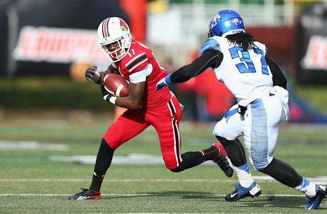 LOUISVILLE, KY - NOVEMBER 23: James Quick #17 of the Louisville Cardinals runs with the ball while defended by Bakari Hollier #37 of the Memphis Tigers during the game at Papa John's Cardinal Stadium on November 23, 2013 in Louisville, Kentucky. (Photo by Andy Lyons/Getty Images)