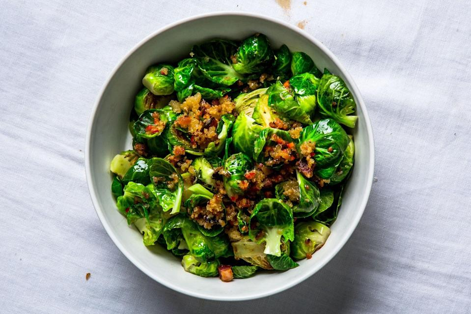 """Trying to convince someone who says they don't like brussels sprouts? This version of the love-it-or-hate-it vegetable is coated in bacony breadcrumbs. Checkmate. <a href=""""https://www.epicurious.com/recipes/food/views/lemony-brussels-sprouts-with-bacon-and-breadcrumbs?mbid=synd_yahoo_rss"""" rel=""""nofollow noopener"""" target=""""_blank"""" data-ylk=""""slk:See recipe."""" class=""""link rapid-noclick-resp"""">See recipe.</a>"""
