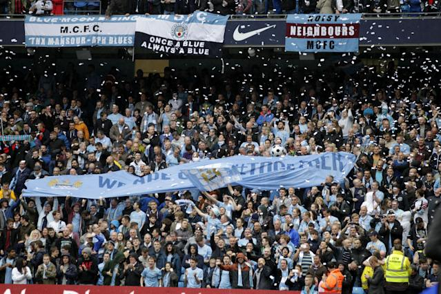 Manchester City fans hold up a banner before the English Premier League soccer match between Manchester City and West Ham at the Etihad Stadium in Manchester, England, Sunday May 11, 2014. (AP Photo/Jon Super)