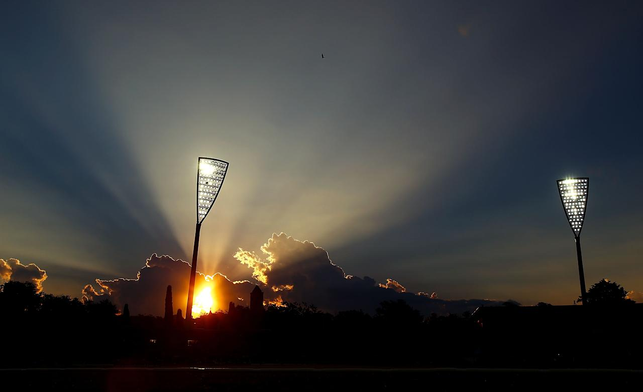 CANBERRA, AUSTRALIA - JANUARY 29:  The sun sets as Manuka Oval  hosts cricket under lights for the first time during the International Tour Match between the Prime Minister's XI and West Indies at Manuka Oval on January 29, 2013 in Canberra, Australia.  (Photo by Mark Nolan/Getty Images)