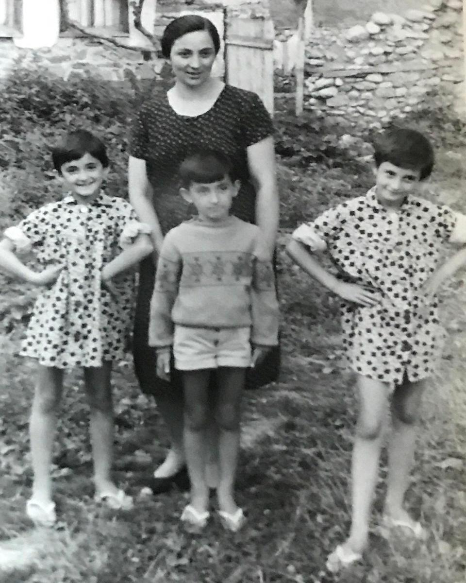 Magbule Malushi with her children Alida (left), Eduard (middle), and Shqipe (right) in Peja, Kosovo.