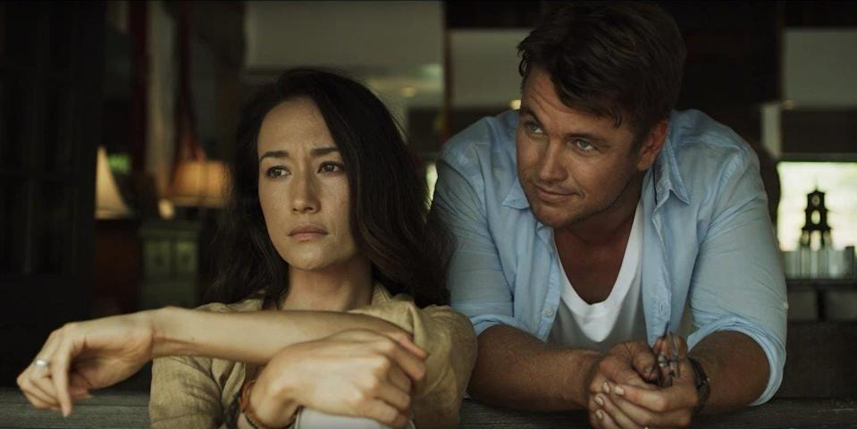 """Maggie Q and Luke Hemsworth star in the horror thriller """"Death of Me"""" as a vacationing couple on an island off the coast of Thailand who wake up hungover, with no memory of the night before, and find footage on their camera of him appearing to murder her."""