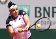 Tunisia's Ons Jabeur plays a return to United States's Coco Gauff during their fourth round match on day 9, of the French Open tennis tournament at Roland Garros in Paris, France, Monday, June 7, 2021. (AP Photo/Michel Euler)