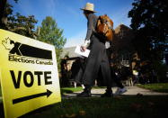 People start to line up early for the Canadian general election before polls open in west-end Toronto for the Monday, Sept. 20, 2021. (Graeme Roy/The Canadian Press via AP)