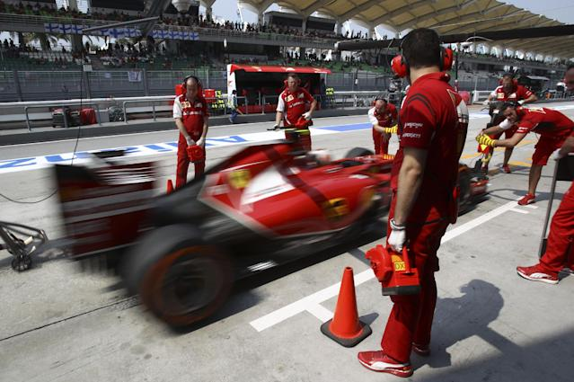 Ferrari driver Kimi Raikkonen of Finland returns to the pit during the first practice session ahead of Sunday's Malaysian Formula One Grand Prix at Sepang International Circuit in Sepang, Malaysia, Friday, March 28, 2014. (AP Photo/Lai Seng Sin)
