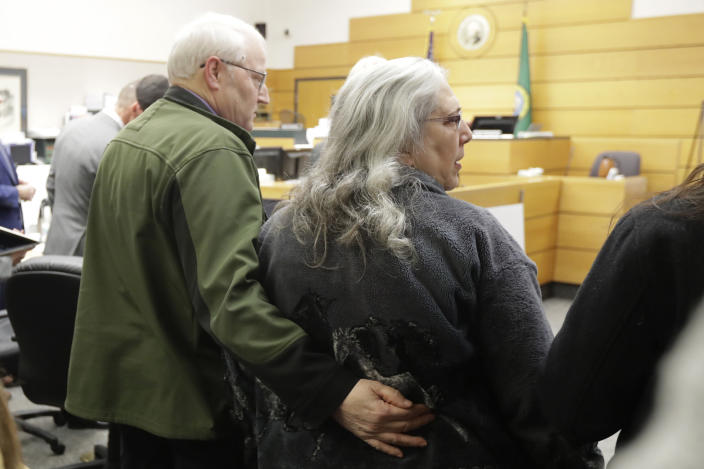 Chuck Cox, left, and his wife, Judy Cox, right, stand Tuesday, Feb. 18, 2020, during a break in a session of Pierce County Superior Court in Tacoma, Wash., on the first day of a civil lawsuit over the murder of the Cox's young grandsons. Chuck and Judy are the parents of missing Utah woman Susan Cox Powell and the grandparents of Susan's sons Charlie and Braden, who were attacked and killed by their father Josh Powell in 2012 while he was under suspicion for Susan Powell's disappearance. The Coxes allege that negligence by the Washington state Department of Social and Health Services was a contributing factor that led to the deaths of their grandsons. (AP Photo/Ted S. Warren)
