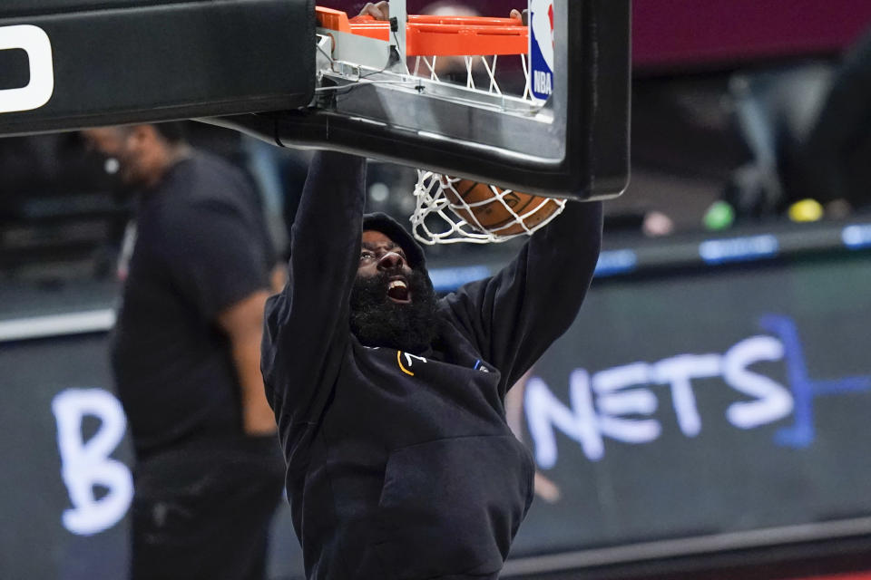 Brooklyn Nets' James Harden dunks before an NBA basketball game against the Cleveland Cavaliers, Sunday, May 16, 2021, in New York. (AP Photo/Frank Franklin II)