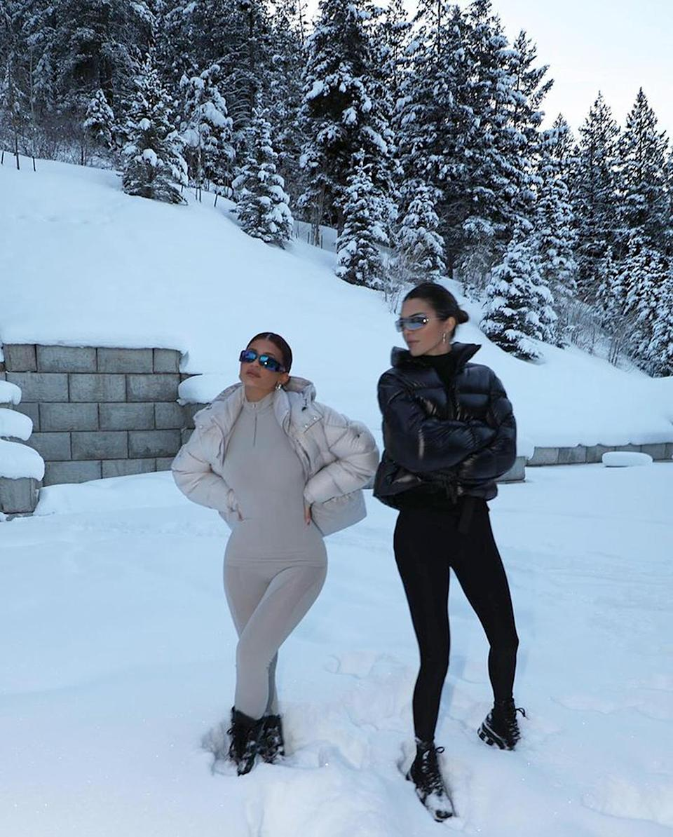 """<p>The sisters rang in the New Year together in the snow, <a href=""""https://www.instagram.com/kyliejenner/"""" rel=""""nofollow noopener"""" target=""""_blank"""" data-ylk=""""slk:wearing coordinating black and white outfits"""" class=""""link rapid-noclick-resp"""">wearing coordinating black and white outfits</a>. </p>"""