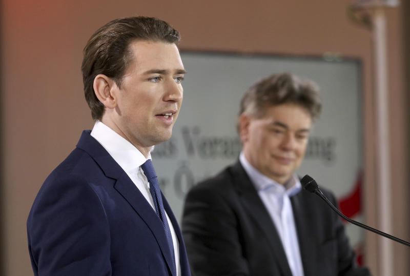 Sebastian Kurz, left, head of the Austrian People's Party, OEVP, and Werner Kogler, right, head of the Austrian Greens speak to journalists during a press conference about the government program in Vienna, Austria, Thursday, Jan. 2, 2020. (AP Photo/Ronald Zak)