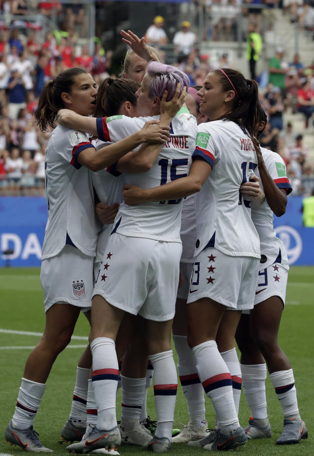 United States' Megan Rapinoe, front, celebrates with teammates after scoring the opening goal from a penalty spot during the Women's World Cup round of 16 soccer match between Spain and US at the Stade Auguste-Delaune in Reims, France, Monday, June 24, 2019. (AP Photo/Alessandra Tarantino)