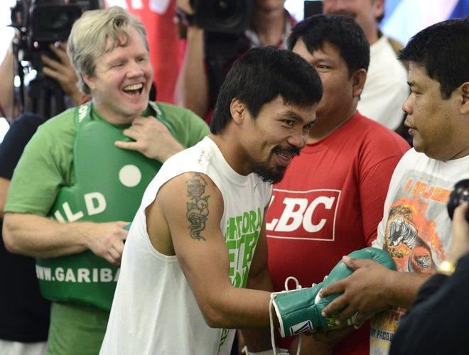 Freddie Roach (L) and Manny Pacquiao (R) of the Philippinesprepare for a media workout at Wild Card Boxing Club on May 30, 2012 in Hollywood, California. The workout is in advance of Pacquiao's upcoming WBO welterweight championship fight against Timothy Bradley of US on June 9 at the MGM Grand in Las Vegas. AFP PHOTO/JOE KLAMARJOE KLAMAR/AFP/GettyImages