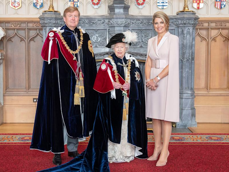The Queen poses with the Netherlands' King Willem-Alexander and Queen Maxima in Windsor on June 17 after the king was invested as a supernumerary Knight of the Garter, a Stranger Knight of the Garter, ahead of the annual Order of the Garter service. (Photo: WPA Pool via Getty Images)